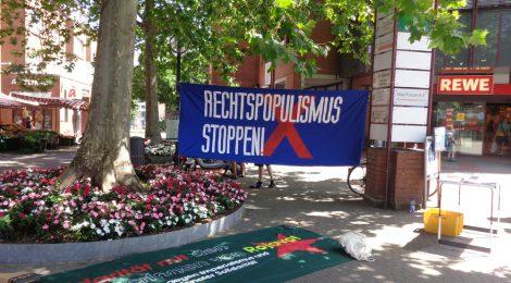 [Stuttgart] Fluchtursachen bekämpfen: Stadtteilspaziergang, Infotisch, Flyer, Sticker und Transpis
